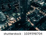 skyline city in the night | Shutterstock . vector #1039598704