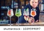 barman in pub or restaurant ... | Shutterstock . vector #1039599097
