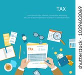 tax calculation payment concept.... | Shutterstock . vector #1039603069