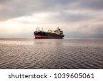 a huge ship  a dry cargo ship... | Shutterstock . vector #1039605061
