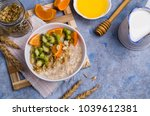 oatmeal with fruit in a plate... | Shutterstock . vector #1039612381