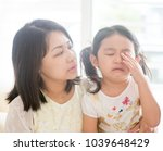 mother comforting crying child. ... | Shutterstock . vector #1039648429