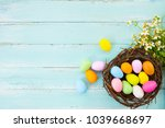 colorful easter eggs in nest... | Shutterstock . vector #1039668697