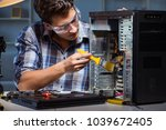 computer repair man cleaning...   Shutterstock . vector #1039672405