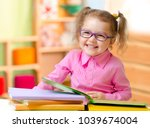 kid in eyeglasses or spectacles ... | Shutterstock . vector #1039674004