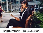 serious female manager in suit... | Shutterstock . vector #1039680805