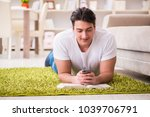 man reading book at home on... | Shutterstock . vector #1039706791