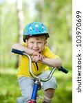 Nice Kid In Helmet On Bicycle