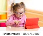 smart kid in spectacles using...   Shutterstock . vector #1039710409