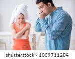 wife and husband looking at... | Shutterstock . vector #1039711204