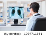 doctor radiologist looking at x ... | Shutterstock . vector #1039711951