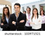 Business group at the office looking confident with arms crossed - stock photo