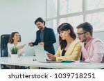 colleagues working at office in ... | Shutterstock . vector #1039718251