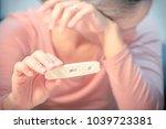 negative pregnancy test result... | Shutterstock . vector #1039723381