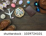 Small photo of Table top view shot of decoration Happy Easter holiday background concept.Flat lay essential objects plan to travel vacation on modern brown wood at office desk.space design mock up.item to traveler.