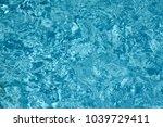 blue swimming pool rippled... | Shutterstock . vector #1039729411