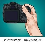 hand holding professional photo ... | Shutterstock .eps vector #1039735504