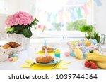 easter breakfast table setting. ...   Shutterstock . vector #1039744564
