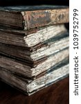 Small photo of stack of classic, vintage, antique books, worn, old and tattered