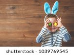 child with bunny ears with... | Shutterstock . vector #1039769545
