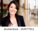 Casual business woman looking happy and smiling - stock photo