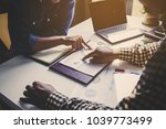 business partners discussing... | Shutterstock . vector #1039773499