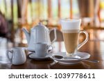 hot latte coffee in long cup on ... | Shutterstock . vector #1039778611
