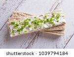 rye crispbread with soft cheese ... | Shutterstock . vector #1039794184