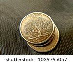 A Dollar Coins On Black...