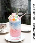Small photo of Pastel milk (drink.beverage) topping with marshmallow and pocky in long glass.