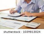 elegant business man working... | Shutterstock . vector #1039813024