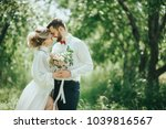 Small photo of stylish bride and groom in the garden. a groom with a beard. fan art. rustic style