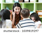 young asian woman teacher... | Shutterstock . vector #1039819297