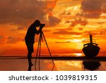 silhouette of a photographer on ... | Shutterstock . vector #1039819315