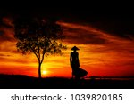 silhouette of a young and fit... | Shutterstock . vector #1039820185