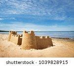 sandcastle on the sea in... | Shutterstock . vector #1039828915