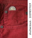 Small photo of Euro coin in a trouser pocket. Pocket money