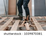 a craft worker man wearing... | Shutterstock . vector #1039870381