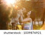 a woman kisses small pet a... | Shutterstock . vector #1039876921