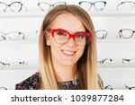 seductive blond woman choosing...   Shutterstock . vector #1039877284