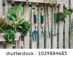 gardening equipment hanging on... | Shutterstock . vector #1039884685
