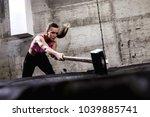 fitness woman hitting wheel... | Shutterstock . vector #1039885741