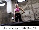 fitness woman hitting wheel... | Shutterstock . vector #1039885744