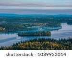 a hazy island in summit lake... | Shutterstock . vector #1039922014