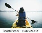 kayaking in the lake | Shutterstock . vector #1039928515