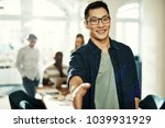 smiling young asian businessman ... | Shutterstock . vector #1039931929