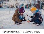 children play outdoors in snow. ... | Shutterstock . vector #1039934407
