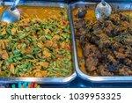 food stall in a market in krabi ... | Shutterstock . vector #1039953325