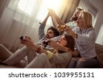 friends playing video games at...   Shutterstock . vector #1039955131