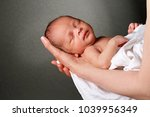 baby in mother's arms | Shutterstock . vector #1039956349